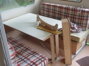 The plan i to remove the table, recover the seats and add extra seating under the window