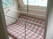 The bed will be at window height on those bars underneath will be storage (curtained off)
