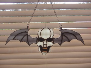 winged skull - commission piece - my first and probably only 'sun' catcher for a goth!